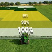 beeld van tractor die over de werkbreedte een gelijkmatige dosis aanbrengt.